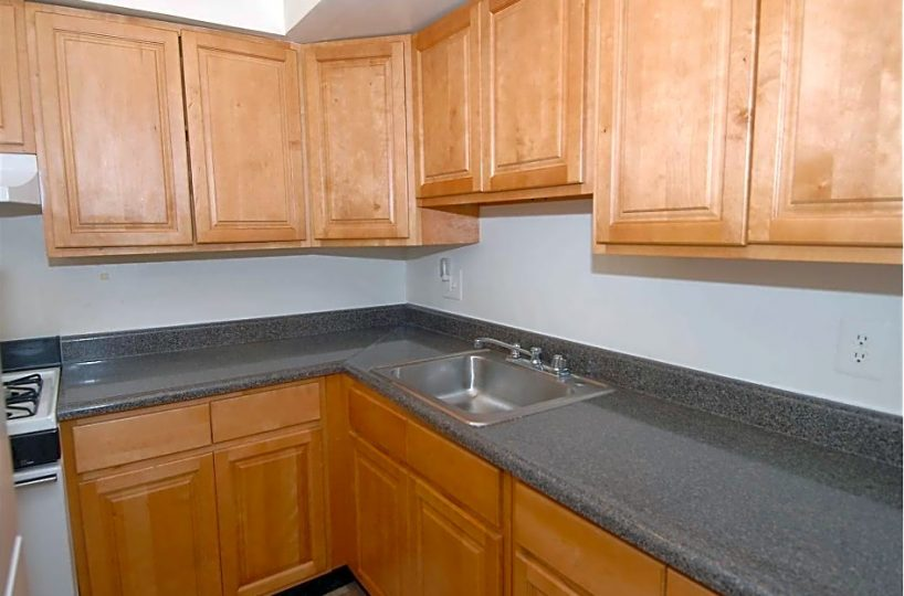 Black Kitchen Counter with Stainless Steel Sink Seminole Court Apartments