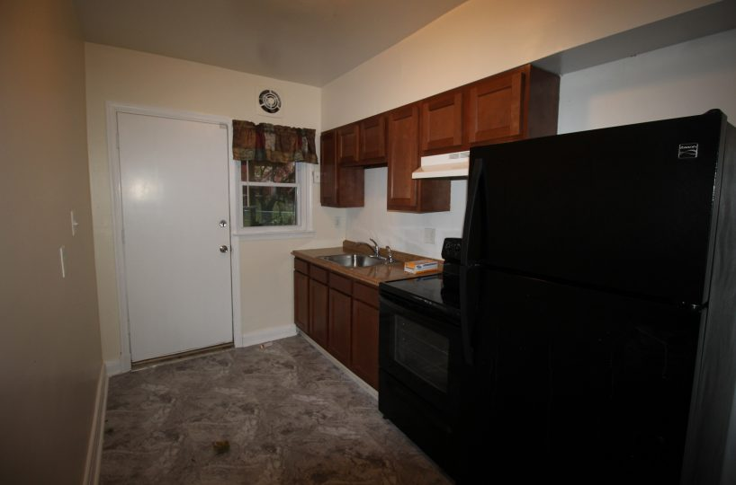 Kitchen with Black Appliances 3834 Greenspring Ave