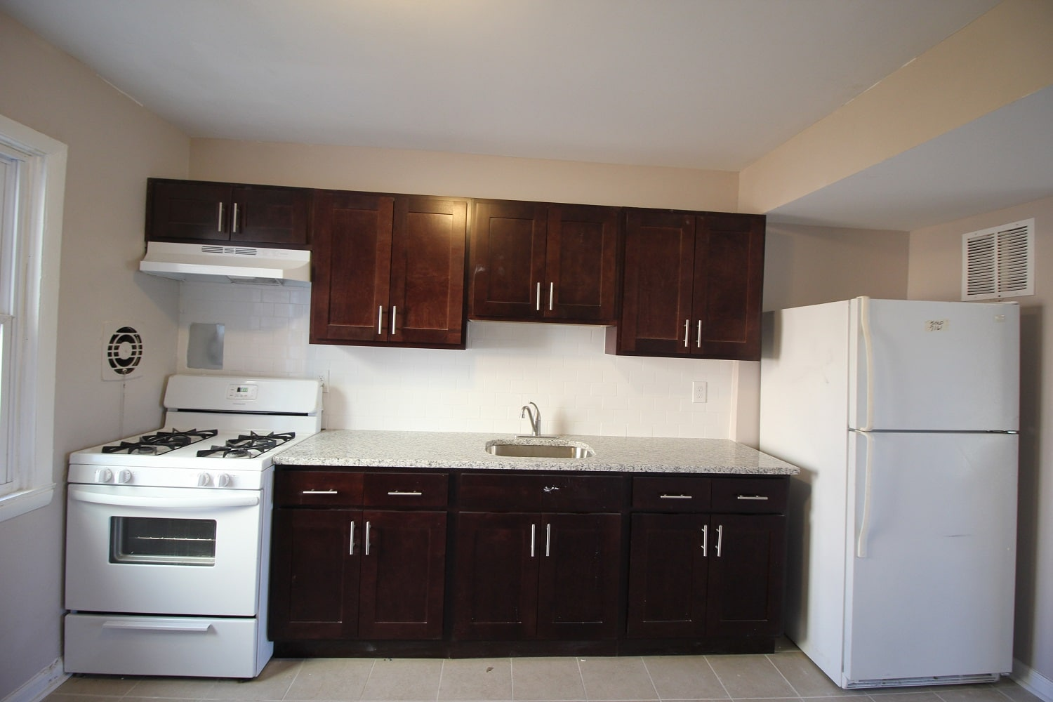 White Oven and Fridge in Kitchen Garrison Townhomes
