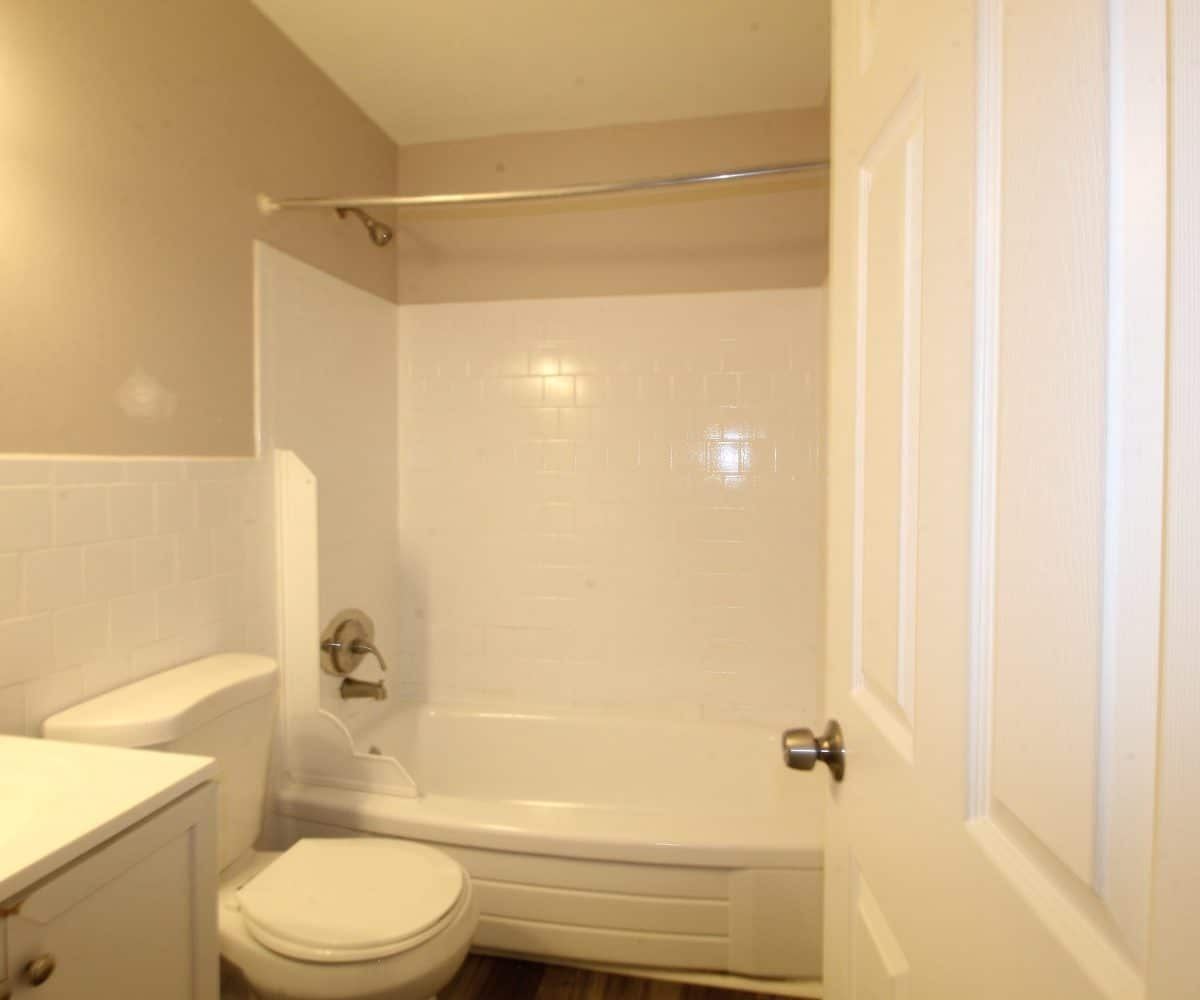 Bathroom with sink, toilet and bathtub at Garrison Townhomes