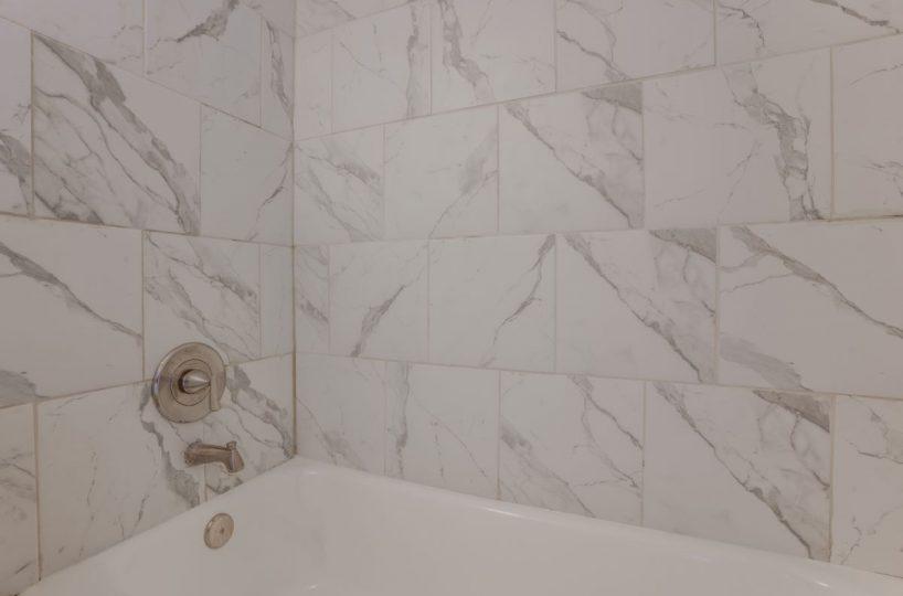 White and Grey Tiled Bathtub 10 E Madison Apt 2D
