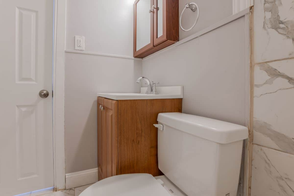 Bathroom with Wooden Cabinet 10 E Madison Apt 2D