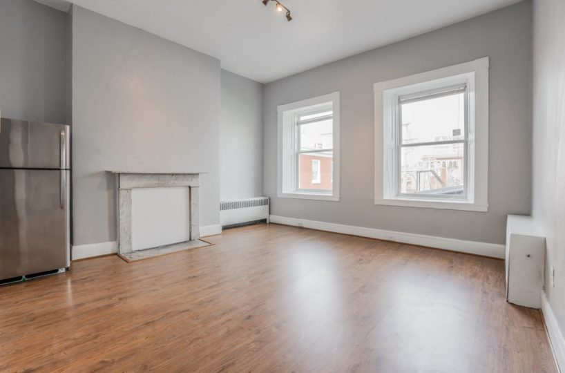 Light Airy Living Room with Brown Flooring 10 E Madison Apt 2D