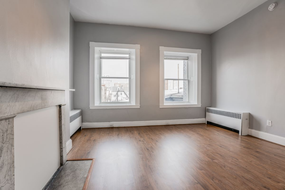 Living Room with Two Large Windows 10 E Madison Apt 2D
