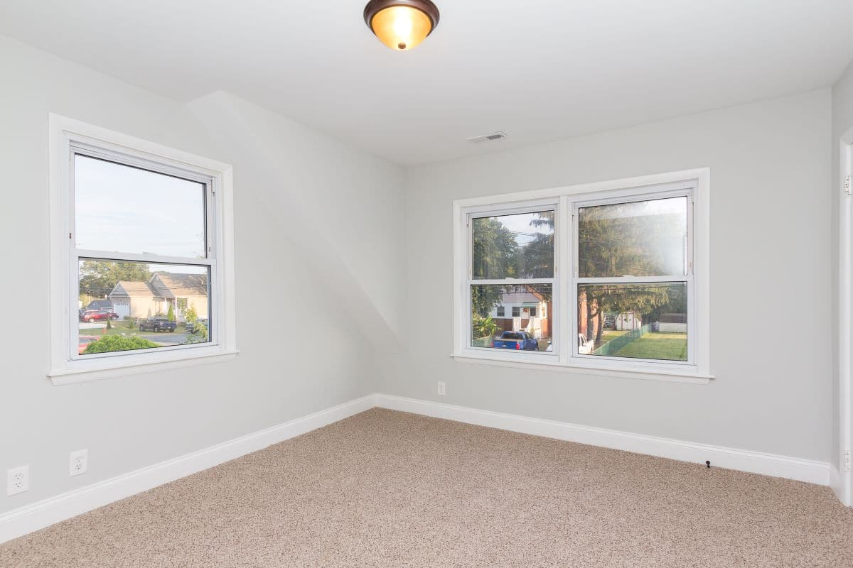 Bedroom with three windows at 7722 N Cove Rd Baltimore