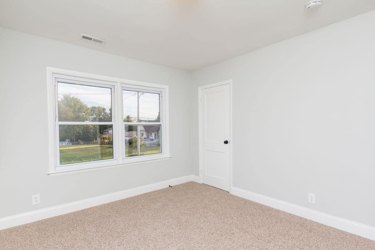 Carpeted Bedroom with large windows 7722 N Cove Road