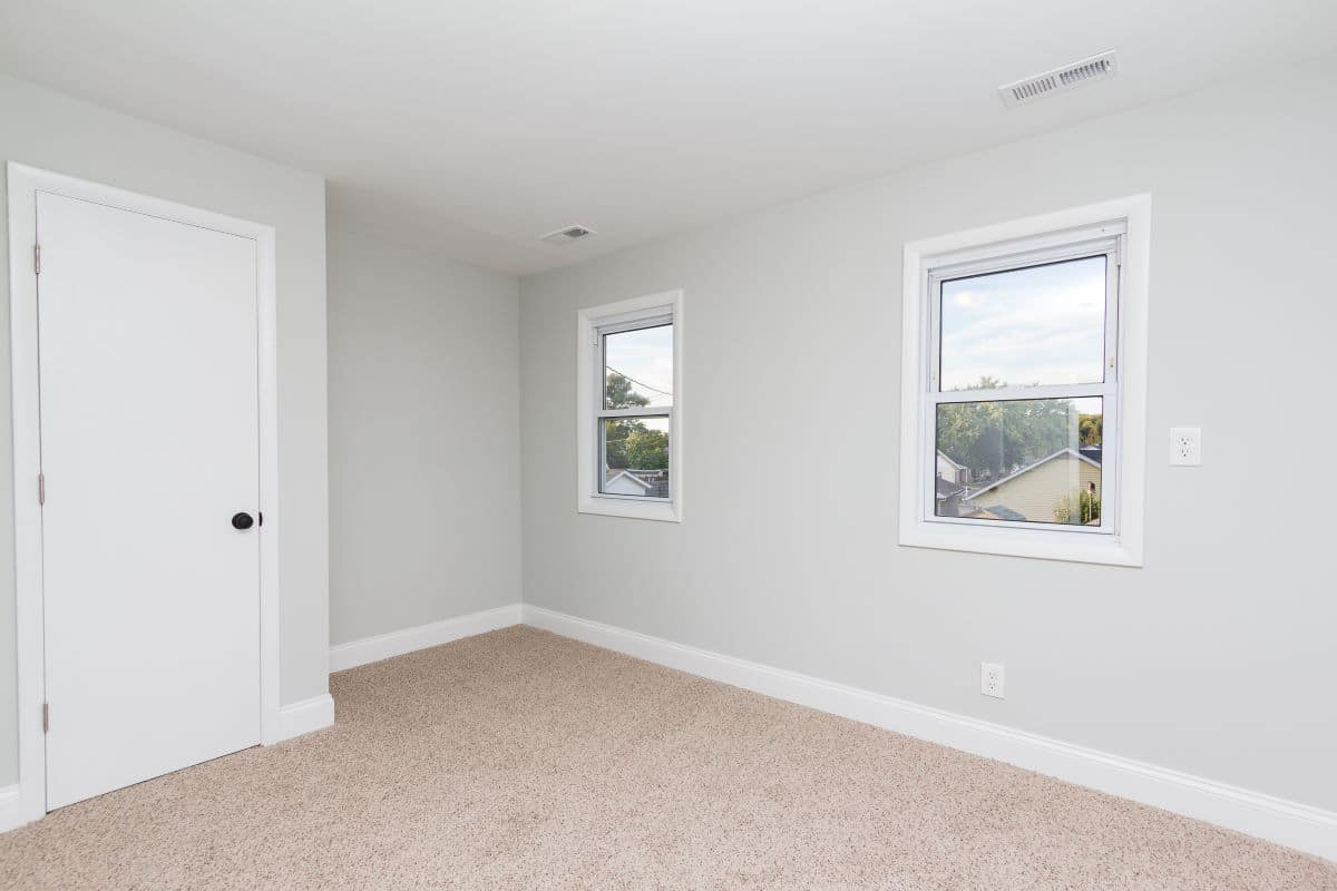 Bedroom with two windows 7722 N Cove Rd