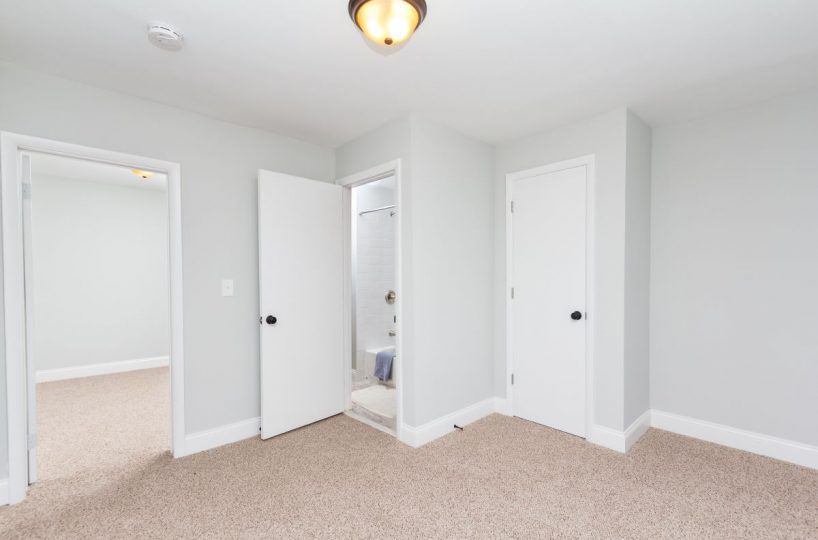Beautiful bedroom with door to bathroom in 7722 N Cove Rd