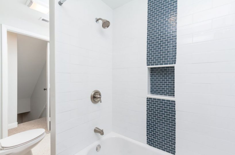 Blue tiled bathtub at 7722 N Cove Road
