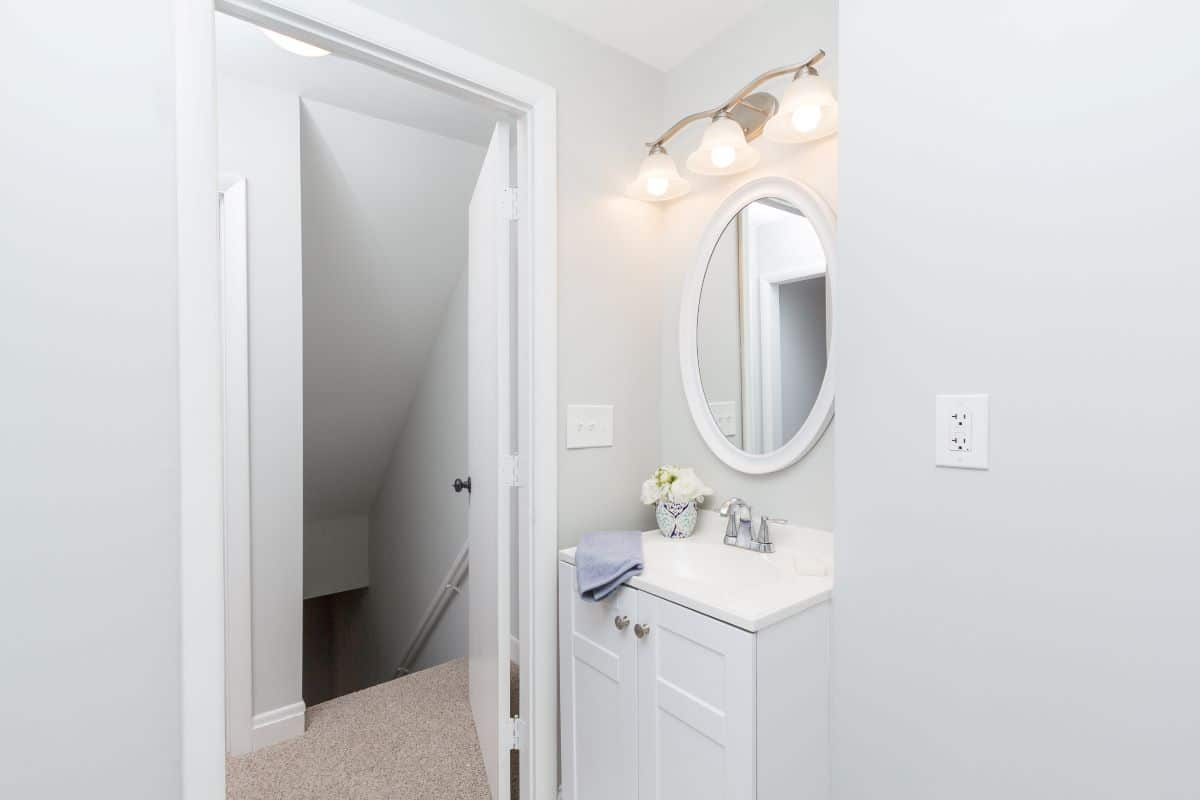 Bathroom sink and mirror at 7722 N Cove Road
