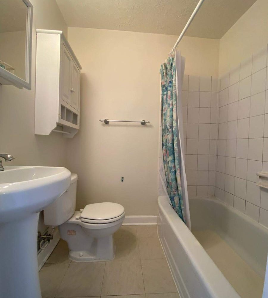 Bathroom with toilet, sink and bathtub at 8357 Ridgely Oak Home in Baltimore