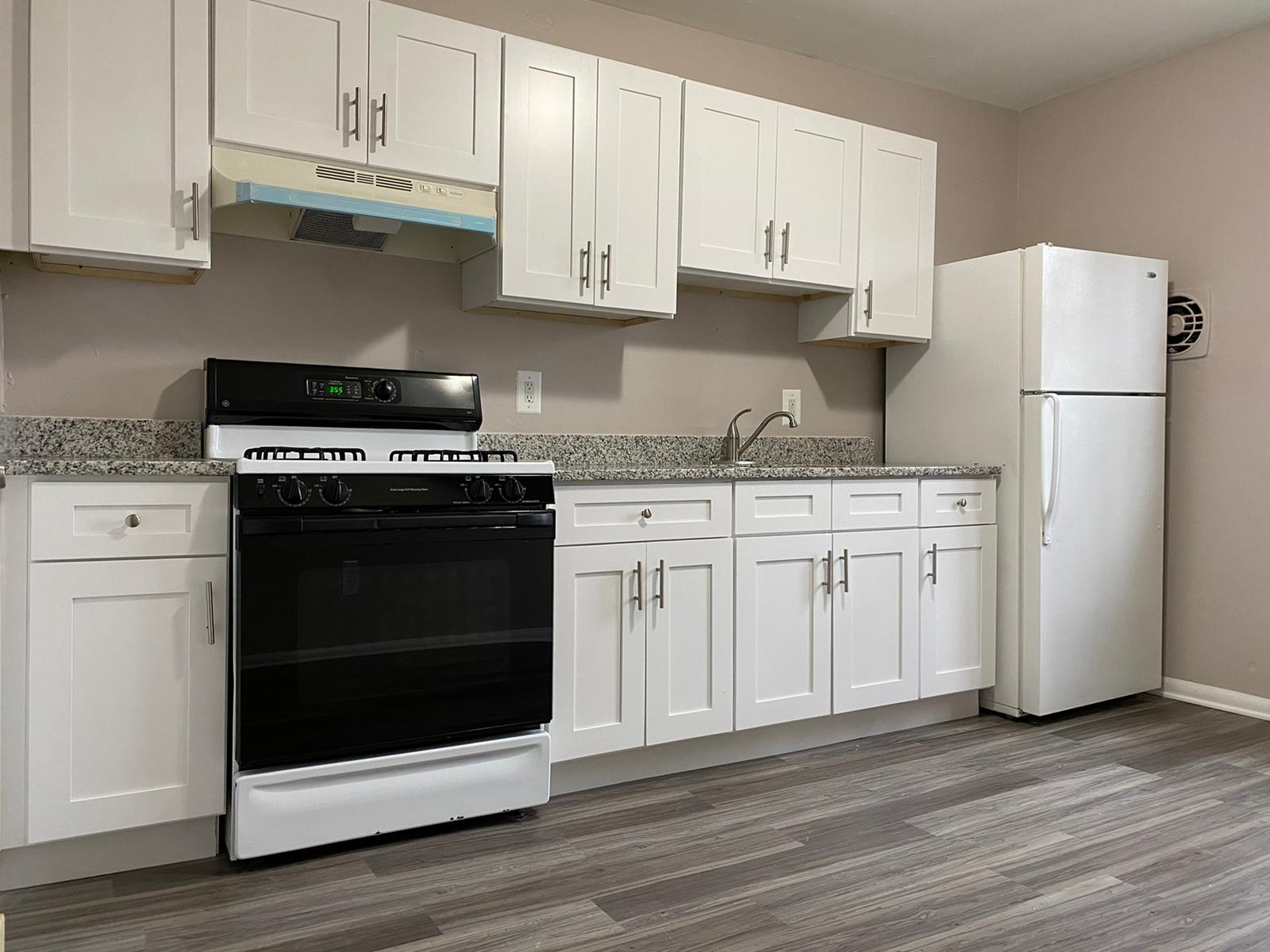 White Kitchen with Oven in Rogers Townhomes