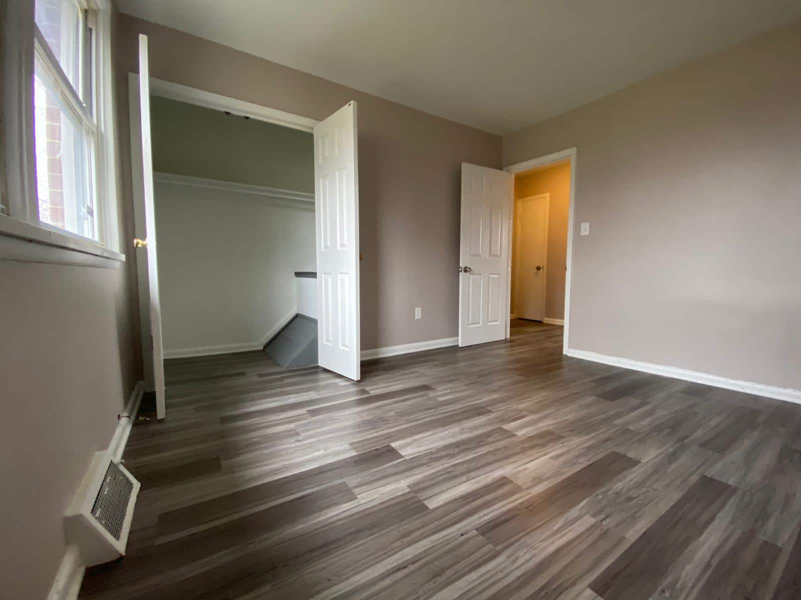 Bedroom with Grey Flooring at Rogers Townhomes