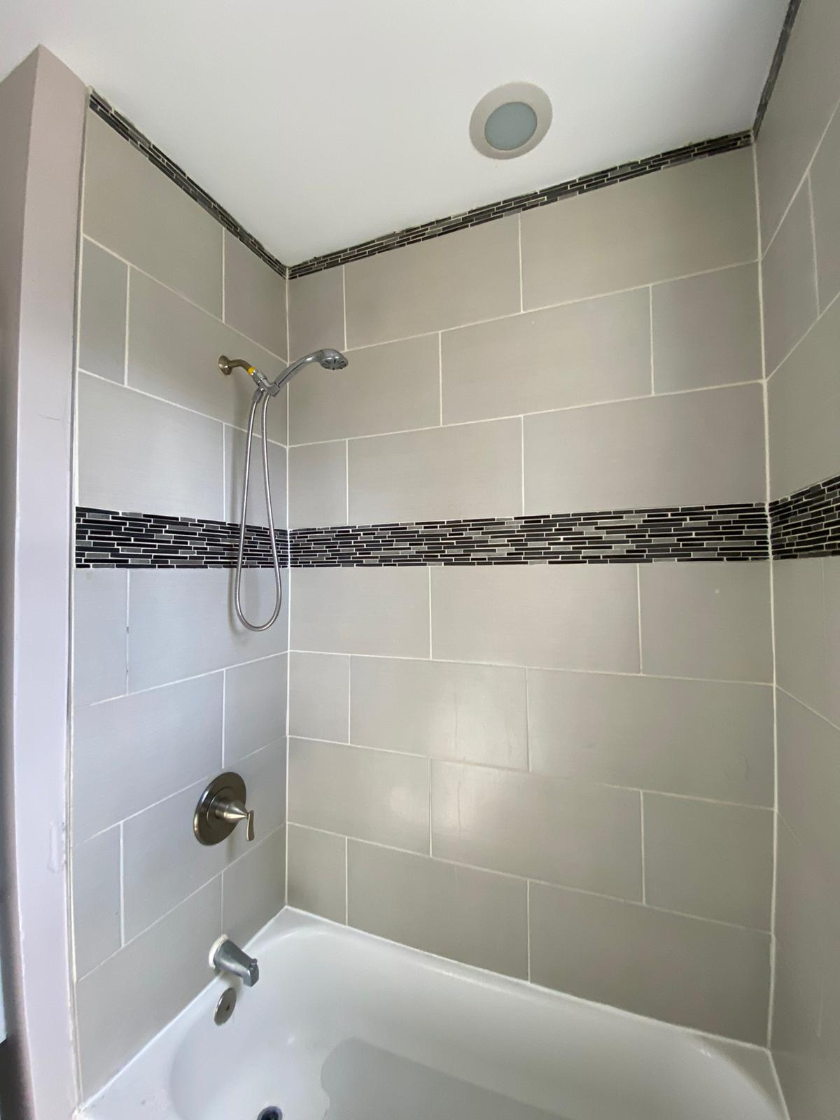 Tiled Bathtub with Spotlight at 534 Beaumont Ave Baltimore