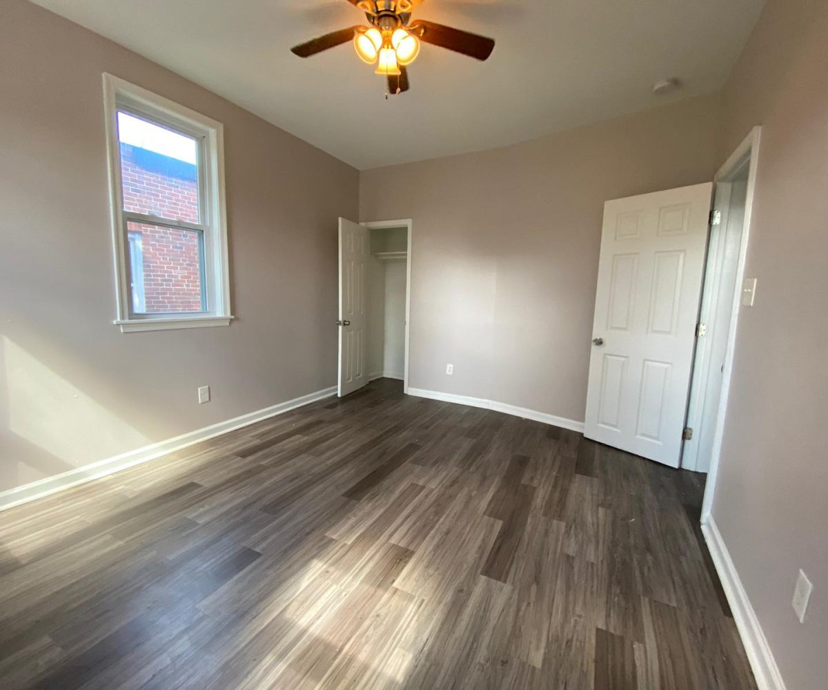 Large Bedroom with Ceiling Fan and Window in 534 Beaumont Home