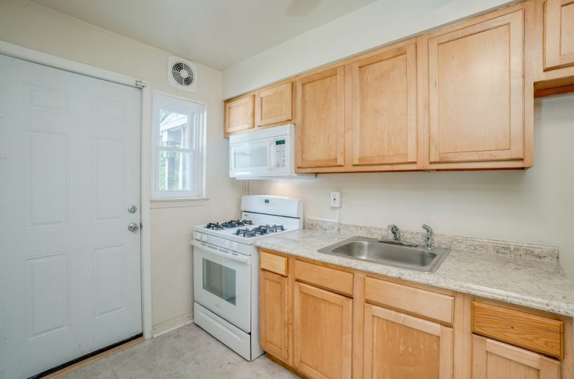 Kitchen with Stainless Steel Sink, Granite Countertop and Wood Cabinets at 345 Endsleigh Ave