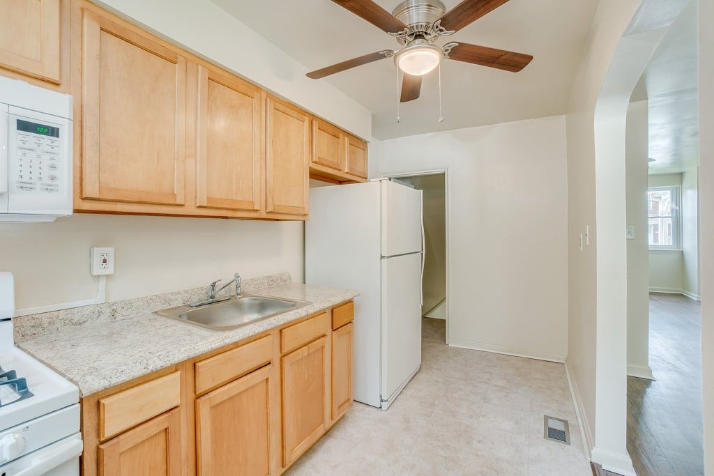 Kitchen with Microwave, Stove, Ceiling Fan and Refrigerator at 345 Endsleigh Ave