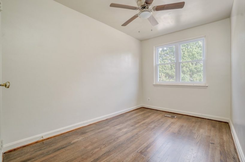 Bedroom with Ceiling Fan and Two Windows With View of Outdoors at 345 Endsleigh Ave