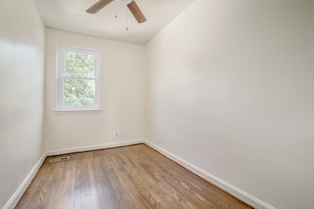 Small White Bedroom with Ceiling Fan and View of Outdoors at 345 Endsleigh Ave
