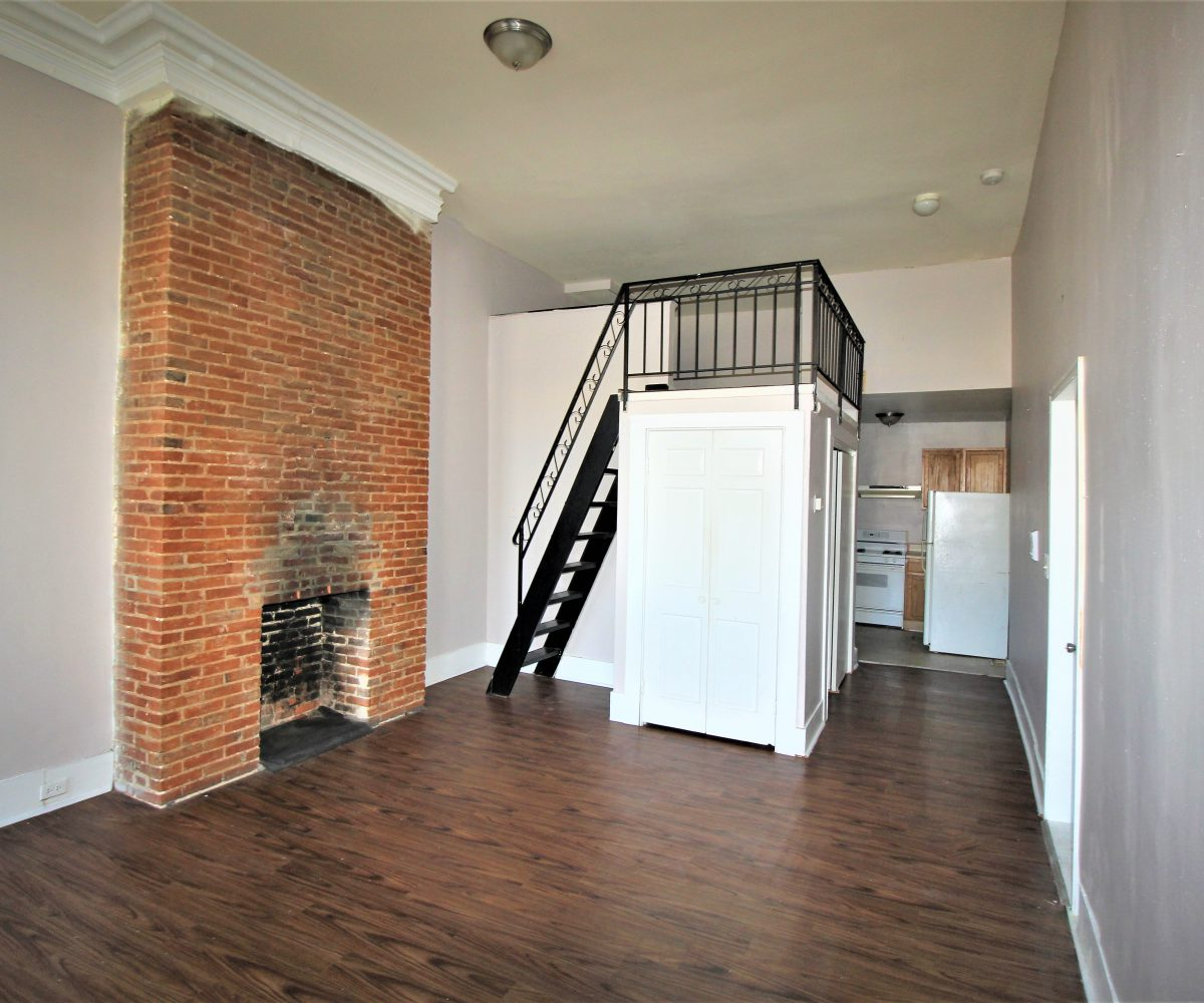 Brick Fireplace in Living Room at 1808 Mcculloh C1F