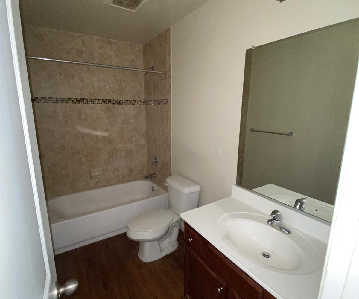 Bathroom with Wood Cabinets at 2505 Woodlawn Ave