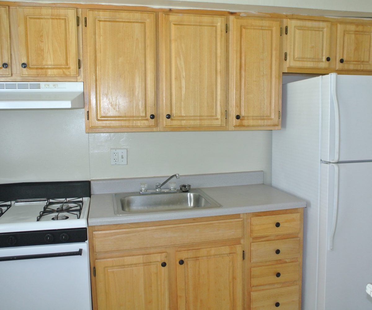 Wood Cabinets in Kitchen at Robinwood Townhomes