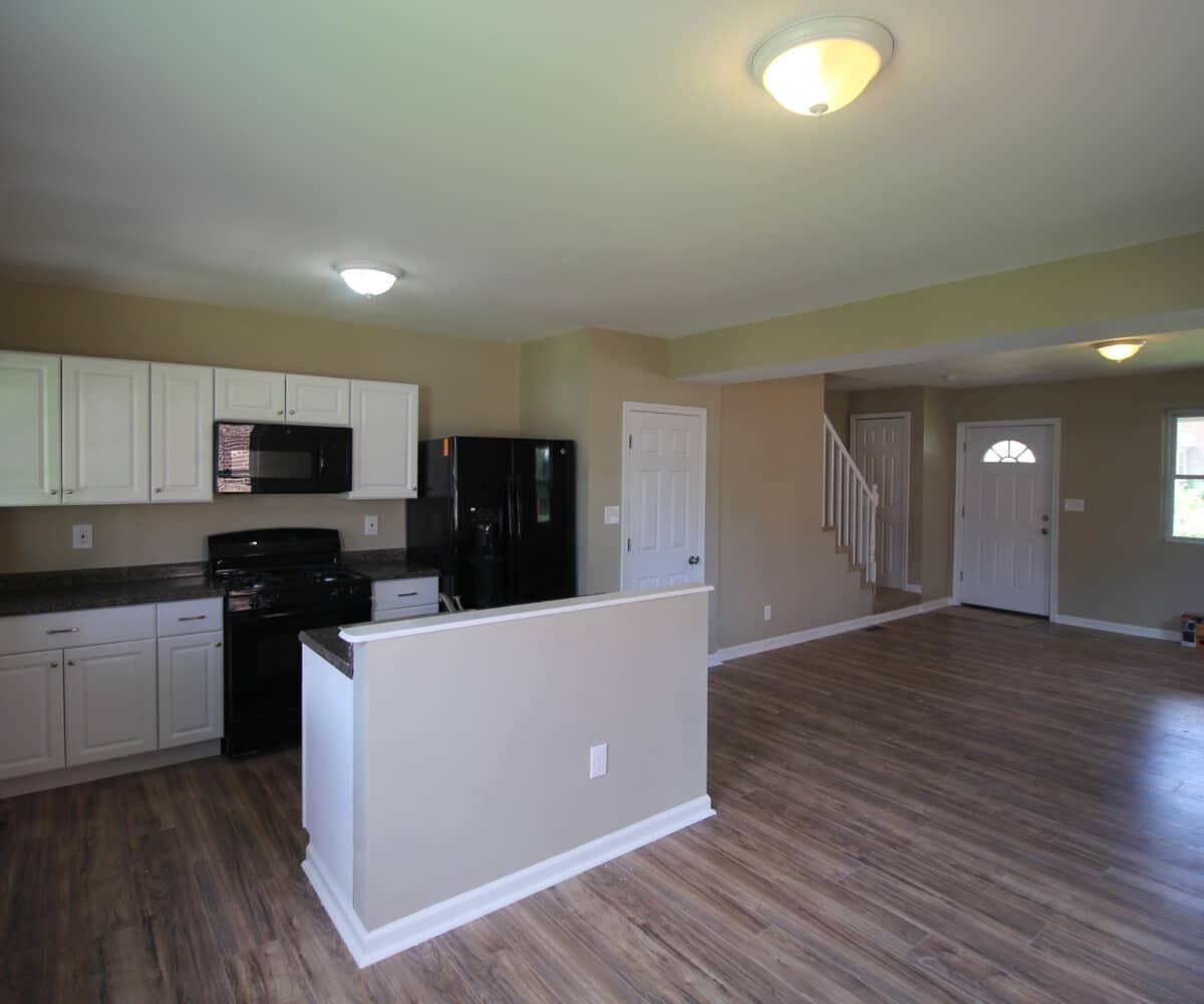 Living Room and Kitchen with Oven and Refrigerator on Kentway
