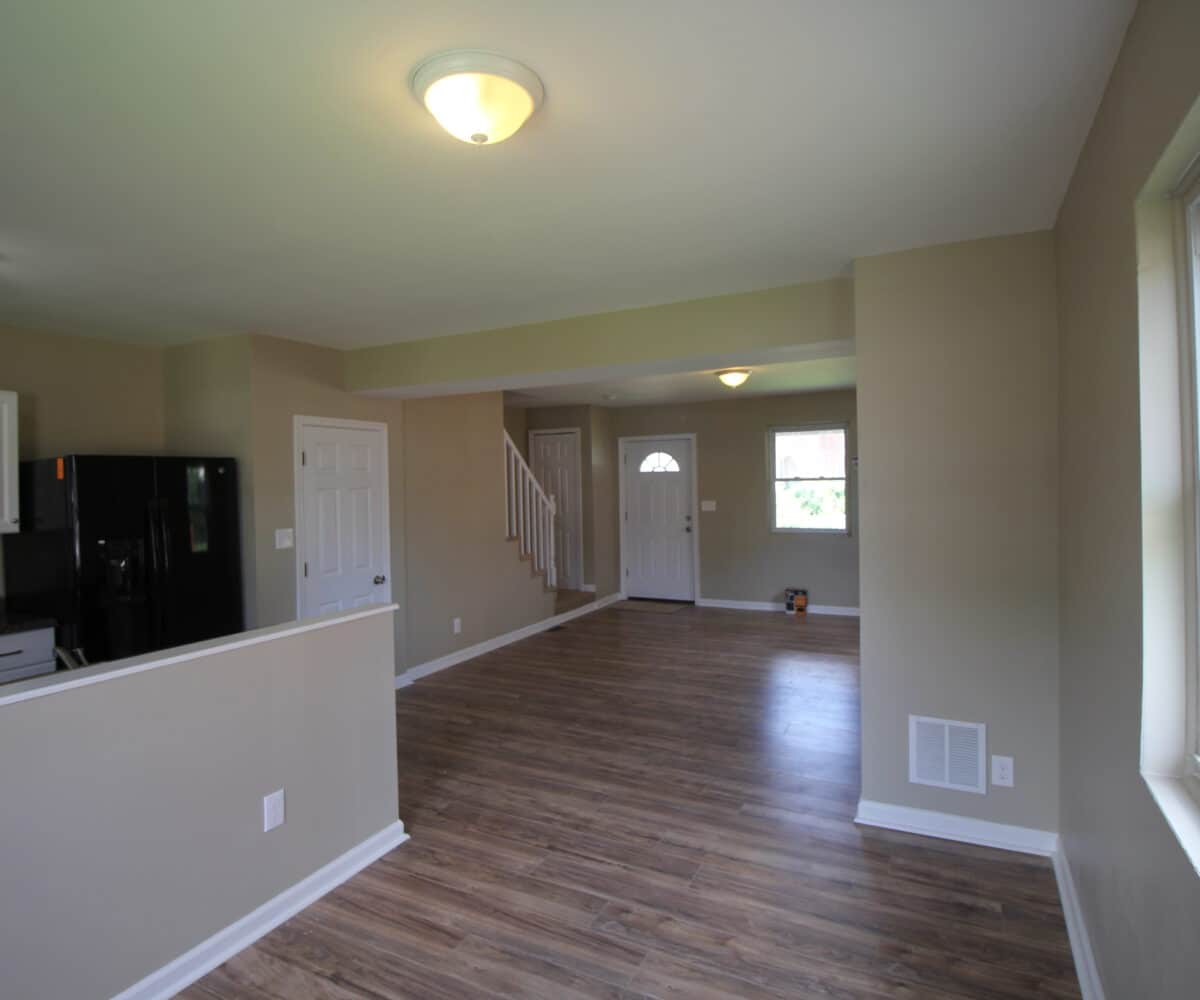 Living Room and Kitchen with View of Front Door