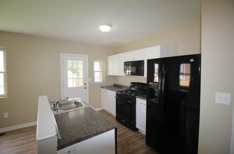 Kitchen with Granite Counters and Black Appliances and Sink on Kentway
