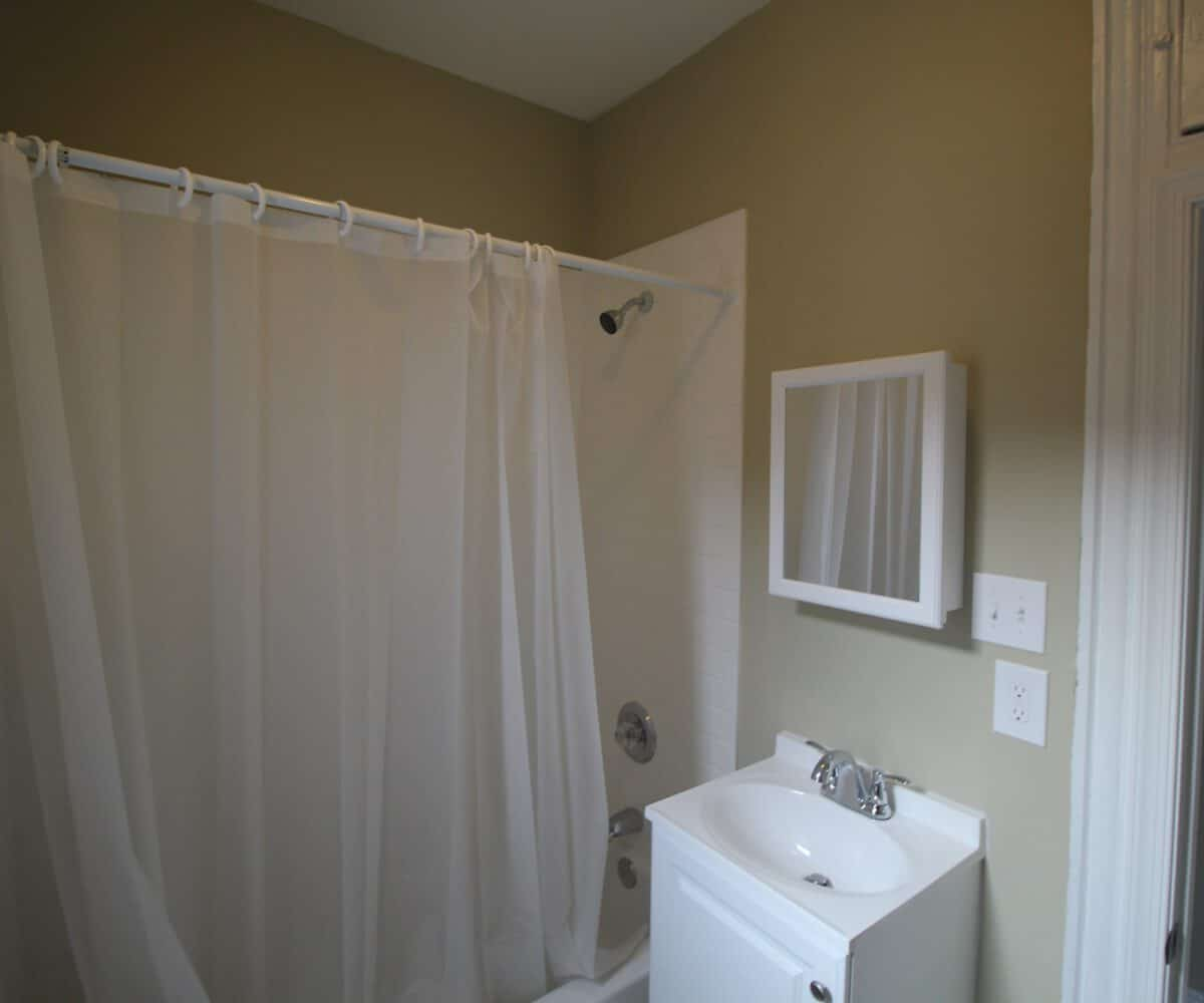 N Luzerne Ave Bathroom with Bathtub with Shower Curtain and Sink